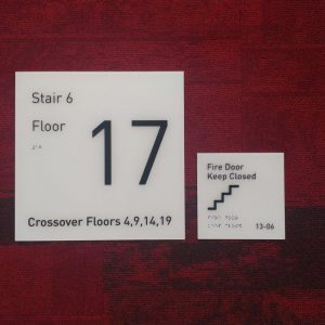 Interior Wayfinding - Room ID Signs with Brailling and Tactile Graphics